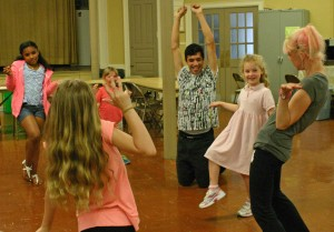 Charlotte's Web Workshop participants do actors' warmups with teaching artists Teague Fernandez and Cheryl Moritz
